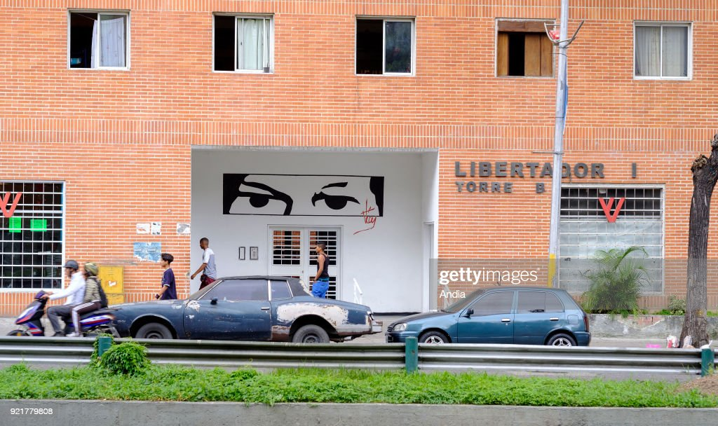 buildings constructed within the framework of the 'Gran Mision Vivienda Venezuela' (Housing Mission) governmental program launched by Hugo Chavez. 'Libertador' building and the eyes of Hugo Chavez, campaign poster used by Maduro in memory of Chavez's Bolivarian revolution.