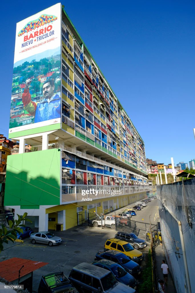buildings constructed within the framework of the 'Gran Mision Vivienda Venezuela' (Housing Mission) governmental program launched by Hugo Chavez. Building with the portrait of Nicolas Maduro highlighting the 'Barrio Nuevo, Barrio Tricolor' mission in support of the underprivileged districts.