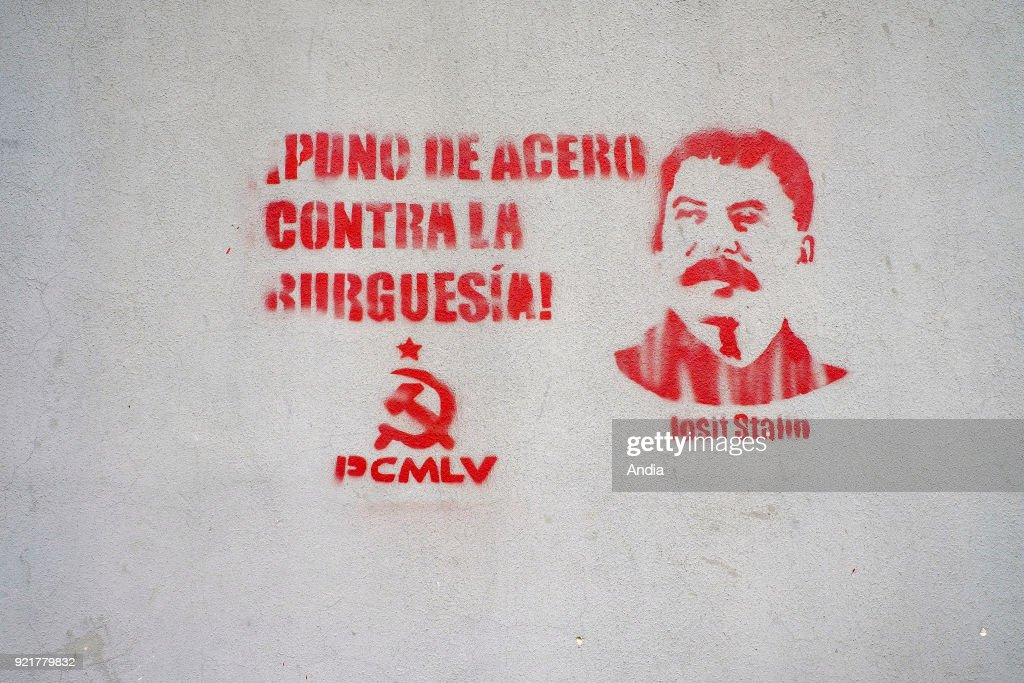 mural painting in the city depicting Stalin with the slogan 'Puno de acero contra la burguesia', a steel fist against bourgeoisie, and the sickle and hammer, symbol of the PCMLV, Marxist‰ÛÒLeninist Communist Party of Venezuela (Spanish: Partido Comunista Marxista-Leninista de Venezuela), a Hoxhaist Communist party in Venezuela.