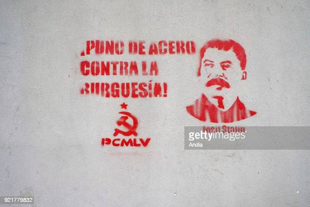 mural painting in the city depicting Stalin with the slogan 'Puno de acero contra la burguesia' a steel fist against bourgeoisie and the sickle and...