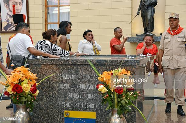 CARACAS Venezuela Supporters visit the stone tomb of former Venezuelan President Hugo Chavez on display at a military facility in Caracas on April 9...