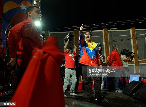 Venezuelan acting President Nicolas Maduro greets supporters during a campaign rally in Puerto Ordaz Bolivar state Venezuela on April 6 2013 One...