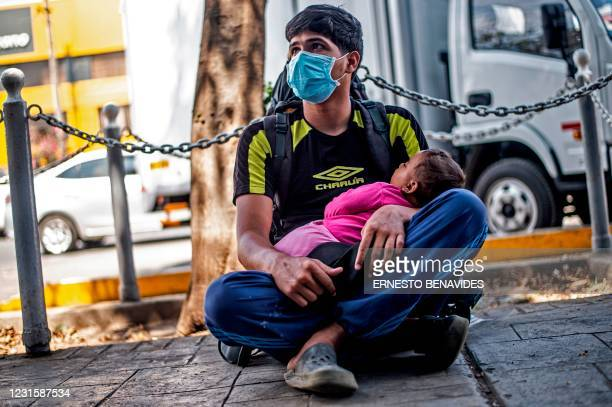 Venezuelan Alexander Mejias a beggar, poses for a photo after an interview with AFP in Lima on March 02, 2021. - Two out of three Venezuelan migrants...