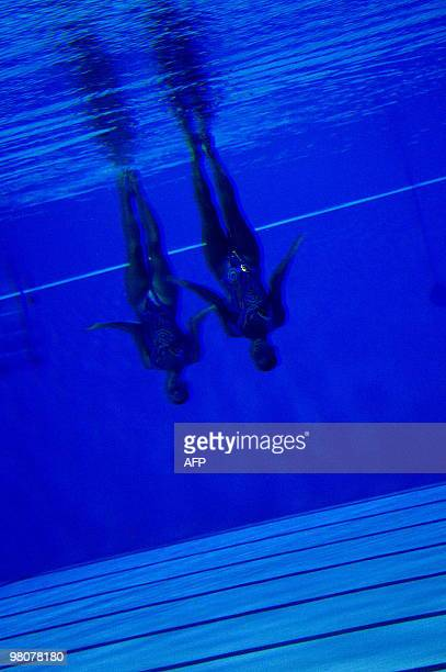 Venezuelan Anna Soto and Maria Angela Soto performs in women's synchronised swimming duet technical rutine during the IX South American Games in...