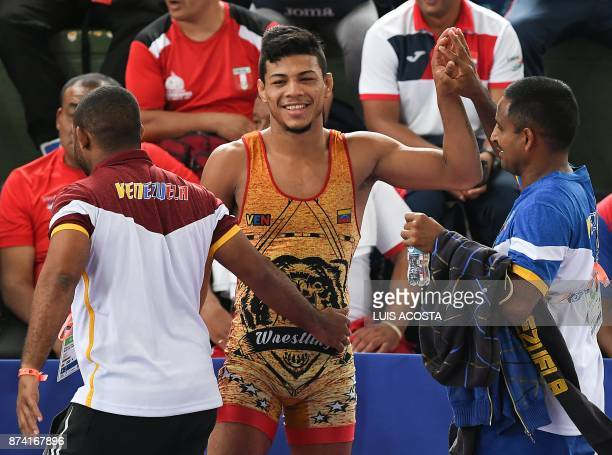 Venezuelan Antonhy Montero celebretes after winning the gold medal in the final of the men's 65 kg GrecoRoman wrestling event during the XVIII...