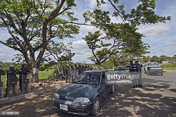 Venezuelan army soldiers control vehicles on March 10 2016 on a road connecting Venezuela to Brazil in Tumeremo Bolivar State where 28 miners...