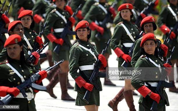 Venezuelan Army women's soldiers march during a military ceremony in conmemoration of the first anniversary of the death of President Hugo Chavez in...
