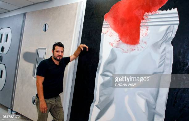 Venezuelan artist Rafael Rangel poses for a picture in his studio in downtown Miami Florida May 18 2018 Rafael Rangel a 39yearold artist emigrated to...
