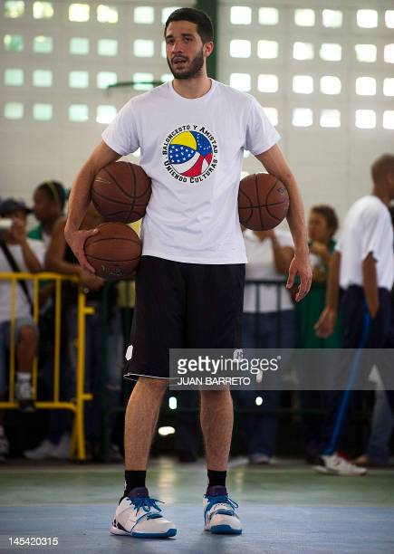 Venezuelan basketball player Greivis Vasquez of the New Orleans Hornets from the NBA is seen during a workshop with children from deprived...