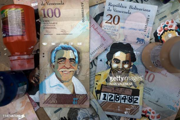 Venezuelan Bolivar bills painted with the images of late Colombian Nobel literature laureate Gabriel Garcia Marquez and late Colombian drug kingpin...
