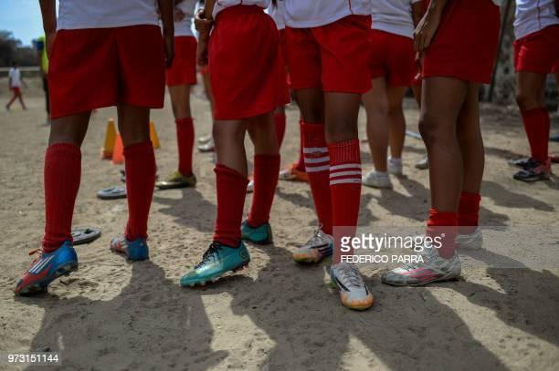 Venezuelan boys attend football classes at the field of the San Jose de Calasanz School in Catia neighborhood in Caracas on June 11 2018 In Catia...