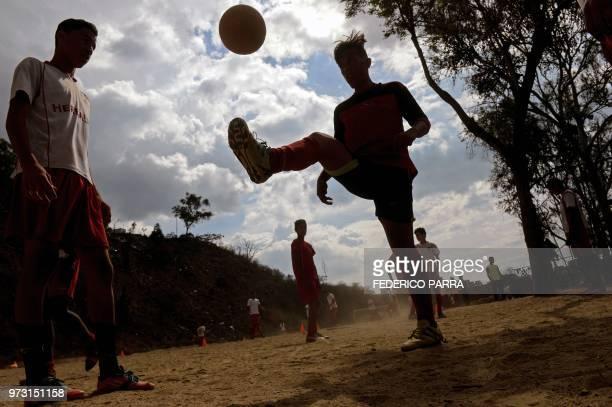 Venezuelan boys attend football classes at the San Jose de Calasanz School in Catia neighborhood in Caracas on June 11 2018 In Catia birthplace of...
