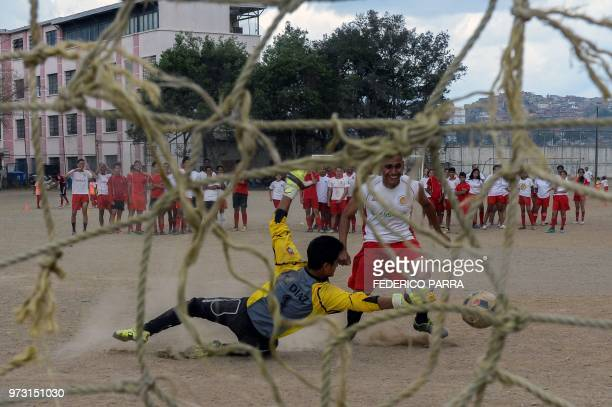 Venezuelan boys play football at the San Jose de Calasanz School in Catia neighborhood in Caracas on June 11 2018 In Catia birthplace of iconic...