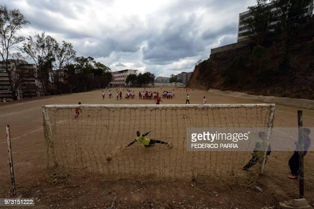 TOPSHOT Venezuelan boys play football at the San Jose de Calasanz School in Catia neighborhood in Caracas on June 11 2018 In Catia birthplace of...