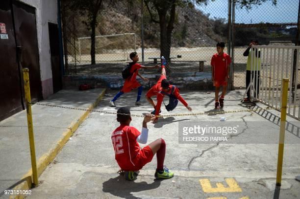 Venezuelan boys play football with a paper ball at the San Jose de Calasanz School in Catia neighborhood in Caracas on June 11 2018 In Catia...