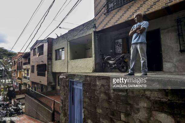 Venezuelan Carlos Figueroa stands outside his house in Medellin Colombia on May 10 2018 Exiled Venezuelans have no expectations of the presidential...
