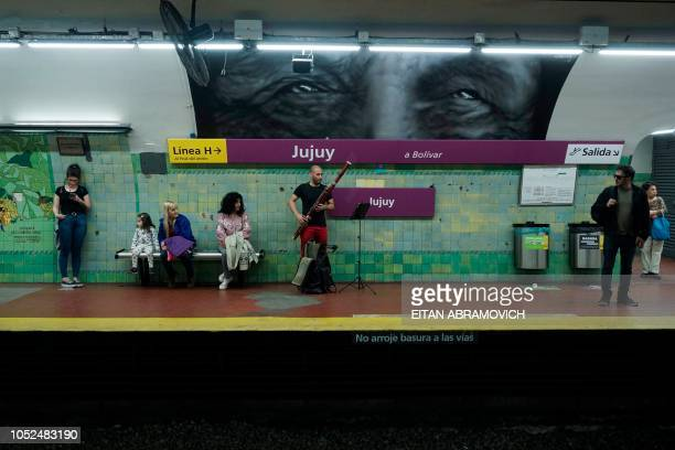Venezuelan Cesar Perez member of the Latin Vox Machine orchestra plays the basson at a subway station in Buenos Aires on October 10 2018 Latin Vox...