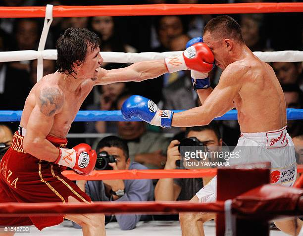 Venezuelan champion Edwin Valero strikes Japanese challenger Takehiro Shimada with a left during the 7th round of their WBA super featherweight title...