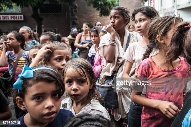 Venezuelan children wait in a food distribution long queue in Caracas Venezula on 23 November 2017 Venezuel people lives between the alert crisis and...