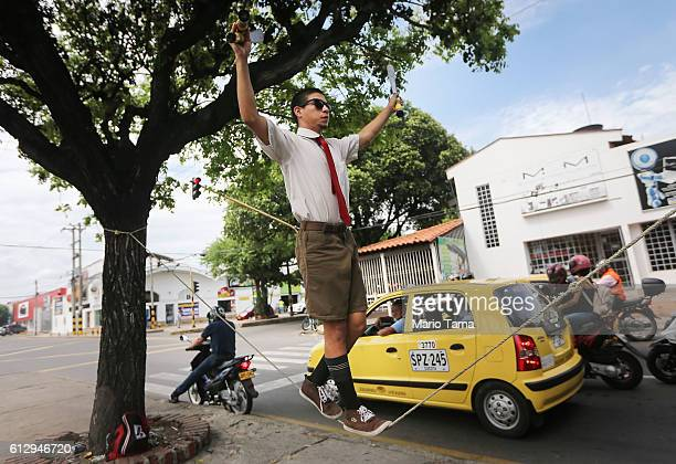 Venezuelan circus performer Anderson performs on the street for donations on October 5, 2016 in Cucuta, Colombia. Anderson said he can make around...