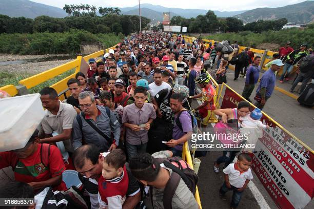 TOPSHOT Venezuelan citizens cross the Simon Bolivar international bridge from San Antonio del Tachira in Venezuela to Norte de Santander province of...