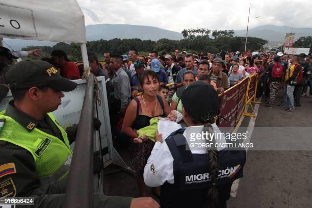 TOPSHOT Venezuelan citizens cross the Simon Bolivar international bridge from San Antonio del Tachira in Venezuela to Norte de Santander province of...