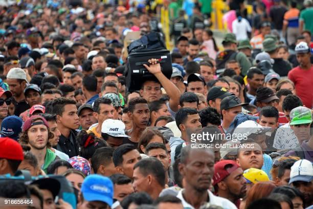 Venezuelan citizens cross the Simon Bolivar international bridge from San Antonio del Tachira in Venezuela to Norte de Santander province of Colombia...