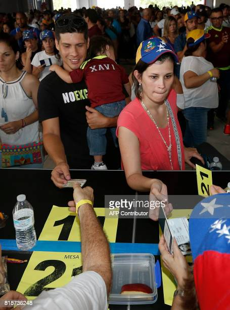 Venezuelan citizens line up to vote in a nonbinding referendum against the Venezuelan governement's plans to rewrite their constitution to stay in...