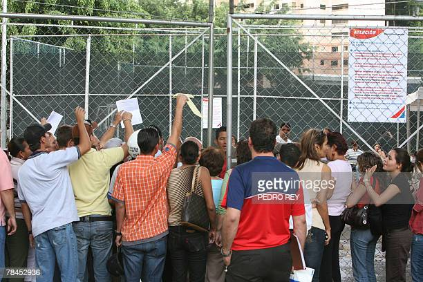 Venezuelan citizens shout slogans in front of the exchange control entity which regulates the annual assignment of up to USD 5000 in credit cards and...