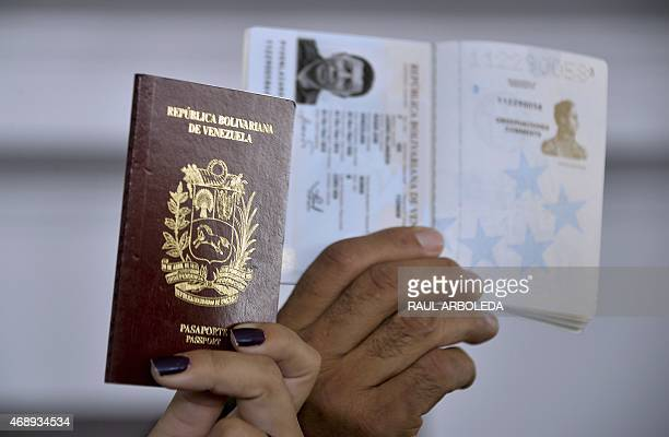 Venezuelan citizens show their passports during a demonstration to express their disagreement about the situation in Venezuela and against the...