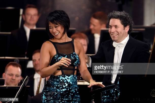 Venezuelan conductor Gustavo Dudamel and Chinese pianist Yuja Wang acknowledge the audience at the end of their performance during the Vienna...