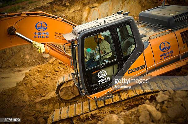 A Venezuelan construction worker drives a bulldozer marked with China Railway Engineering Corp's CREC logo at the TinacoAnaco railway project in Los...