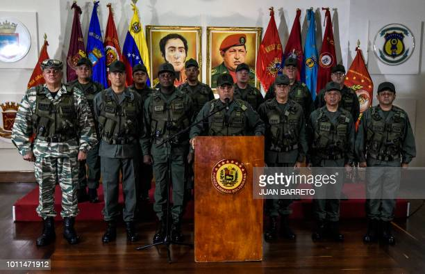 Venezuelan Defence Minister Padrino Lopez flanked by the military high command delivers a press conference in Caracas on August 05 a day after an...