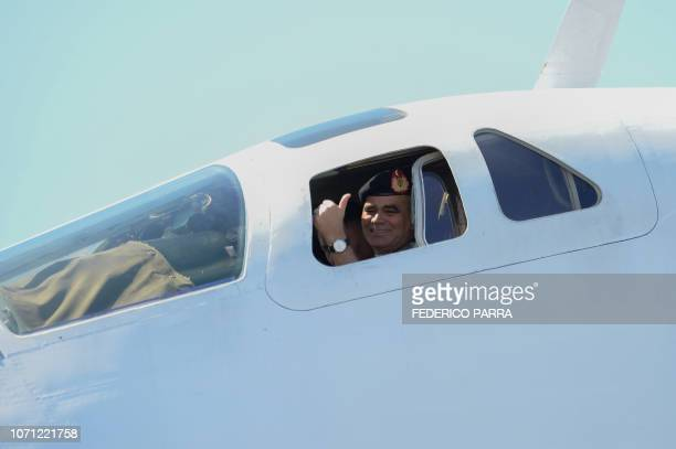 Venezuelan Defence Minister Vladimir Padrino gives his thumb up as he sits on the cockpit of a Russian Tupolev Tu160 strategic longrange heavy...