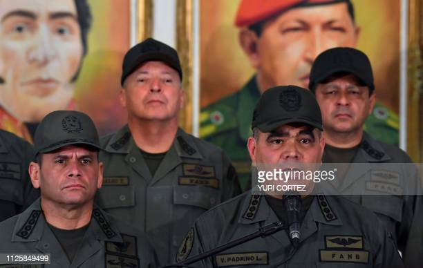 Venezuelan Defense Minister Vladimir Padrino gestures surrounded by military men as he delivers a speech in Caracas on February 19 2019