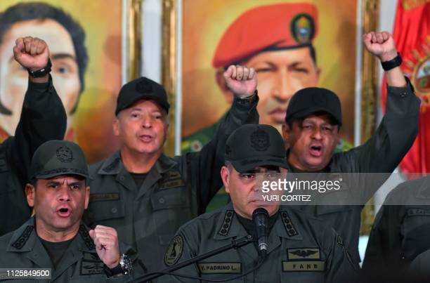 TOPSHOT Venezuelan Defense Minister Vladimir Padrino gestures surrounded by military men as he delivers a speech in Caracas on February 19 2019