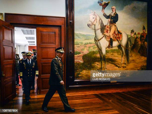 Venezuelan Defense Minister Vladimir Padrino Lopez arrives to delivers a press conference in Caracas along with members of the top military...