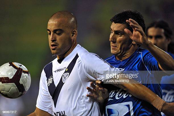 Venezuelan Deportivo Italia's player Javier Lopez vies for the ball with Santiago Silva of Argentinian Velez Sarsfield during their Copa Libertadores...