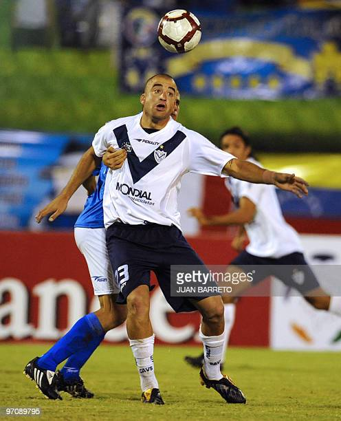 Venezuelan Deportivo Italia's player Javier Lopez vies for the ball with Argentinian Santiago Silva of Velez Sarsfield during their Copa Libertadores...