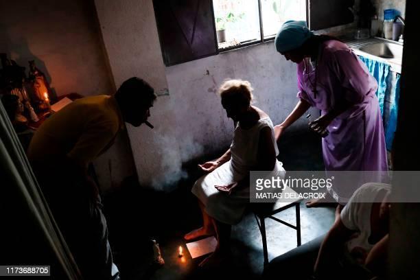 Venezuelan Esperanza Castillo is teated at the clinic of Venezuelan spiritual healer Guayanese Brother in Petare neighborhood Caracas on September 25...
