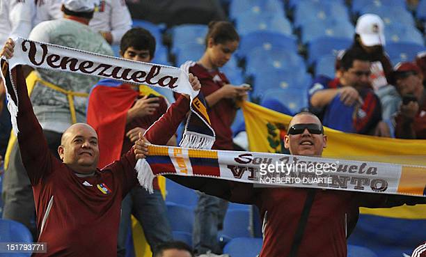 Venezuelan fans cheer for their team before a Brazil 2014 World Cup South American qualifier match against Paraguay at Defensores del Chaco stadium...
