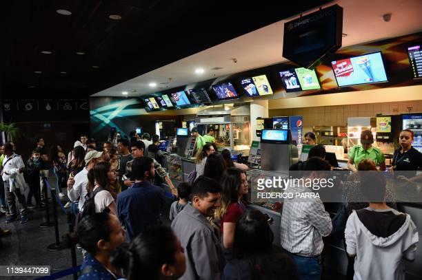 Venezuelan filmgoers buy popcorn to watch the first screening in Venezuela of Marvel Studios' Avengers Endgame at a cinema in Caracas on early April...