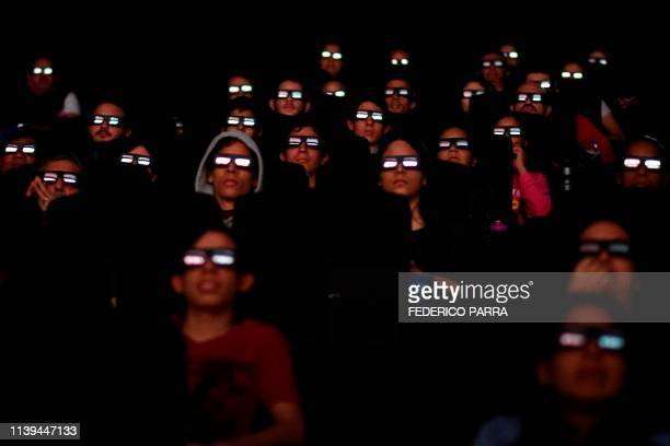 TOPSHOT Venezuelan filmgoers watch the first screening in Venezuela of Marvel Studios' Avengers Endgame at a cinema in Caracas on early April 26 2019...
