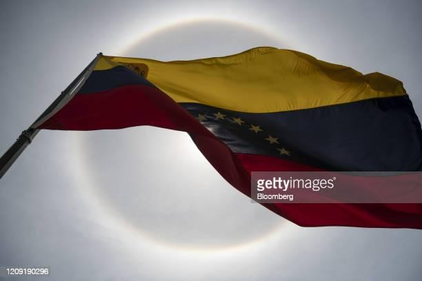 A Venezuelan flag flies during Palm Sunday in Caracas Venezuela on Sunday April 5 2020 Amid the coronavirus as the world's major religions enter one...