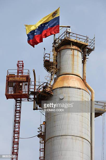 A Venezuelan flag is displayed on a oil refinery in the Venezuelan city of Moron on April 30 2009 The petroleum sector dominates Venezuela's mixed...