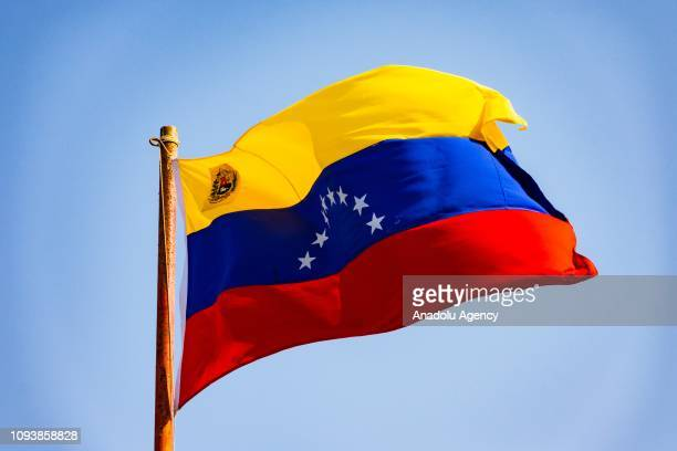 Venezuelan flag is seen at the border between Colombia and Venezuela in Paraguachon in the department of La Guajira Colombia on February 4 2019