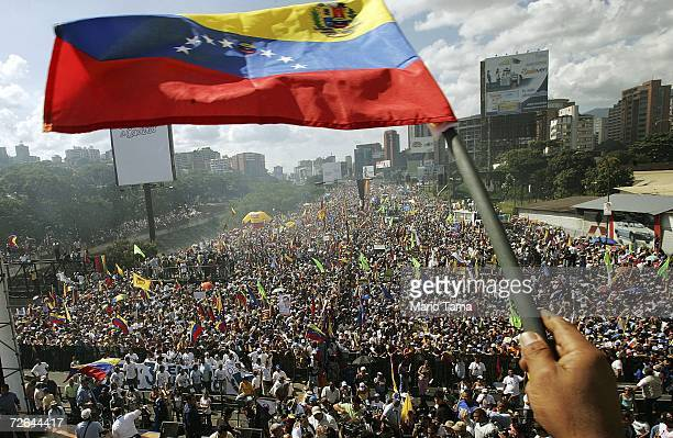 Venezuelan flag is waved at a rally for opposition presidential candidate Manuel Rosales November 25 2006 in Caracas Venezuela Rosales is challenging...