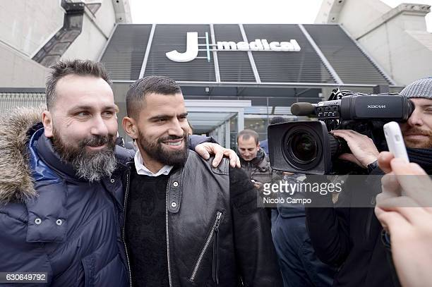 Venezuelan football player Tomas Rincon poses for a photo with a supporter after completing Juventus medical at J Medical The player comes from Genoa...