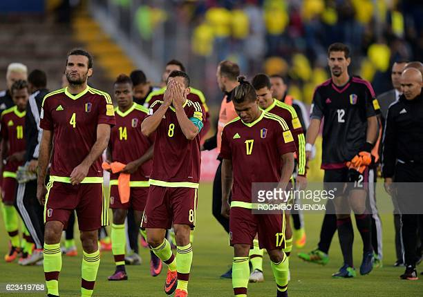TOPSHOT Venezuelan footballers leave the field at the end of their 2018 FIFA World Cup qualifier football match against Ecuador in Quito on November...