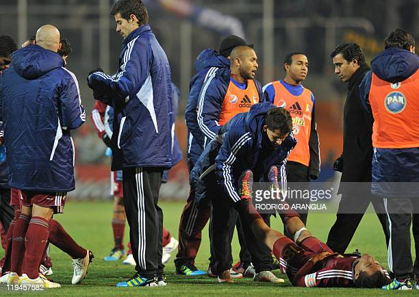 Venezuelan footballers rest at the end of the regulation time during the 2011 Copa America semifinal football match against Paraguay at the Malvinas...